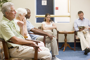 Five people sitting in a doctor's waiting room