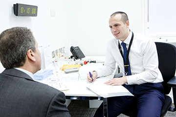 GP registrar undergoing a ten minute clinical competency test consultation with an actor role-playing a patient. Photo credit: Grainge Photography